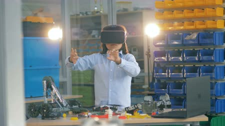 interactive table : School boy in VR glasses, close up. Stock Footage