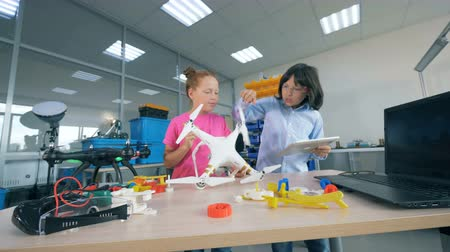inventing : School kids working with UAV in school lab. Stock Footage