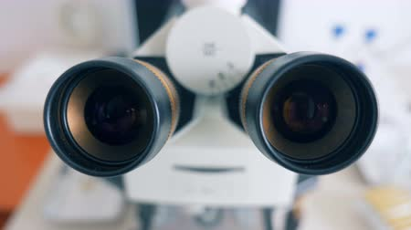 eyepieces : Close up of two oculars of a microscope