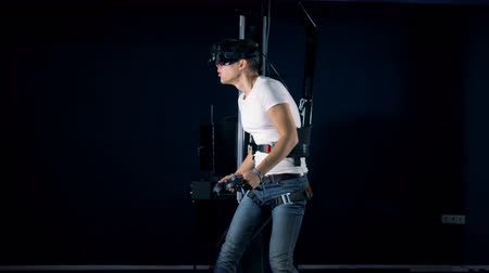 irreal : Male teenager is moving chaotically while using VR platform. Virtual reality headset playing game 360.