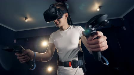equipped : Equipped teenage guy is exploring virtual reality with the help of a simulator