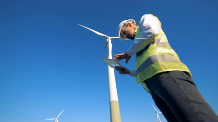 inspector : Wind generators are getting observed by a male expert. Clean, eco-friendly energy concept. Stock Footage