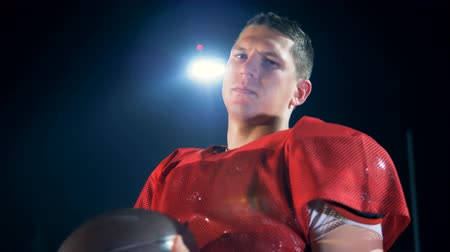 american football player : Determined american football player is twisting the ball in his hands Stock Footage
