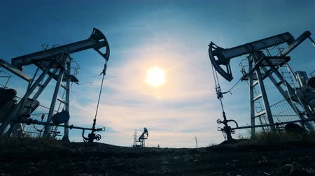 harmful : Several oil extracting machines. Energy, oil, gas, fuel pumping rig. Oil industry, petroleum industry, oil sector concept. Stock Footage