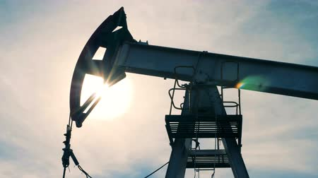 producing energy : Oil, fuel derrick is slowly moving up and down Stock Footage