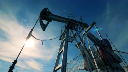 pumping : Fuel-producing mechanism is moving up and down. Energy, oil, gas, fuel pumping rig.