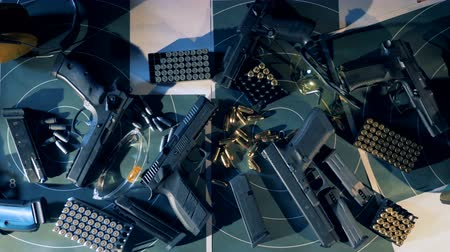 gunshot : Guns, bullets, ammunition. Equipment for shooting training top view. Stock Footage