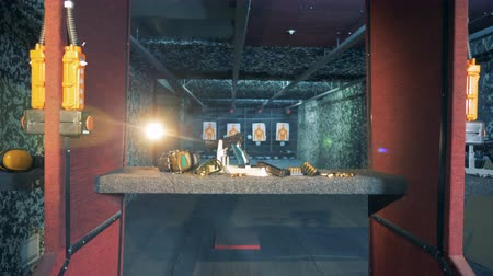 триггер : A big shooting space with guns and equipment. Ammunition, guns, weapons at a fire range.