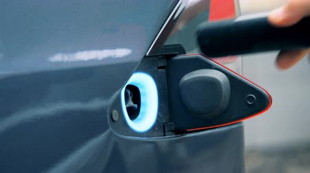 tesla car : Start of a fuelling process of an electric car Stock Footage