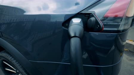 sustainable resources : Battery-driven car is getting refueled with electricity Stock Footage