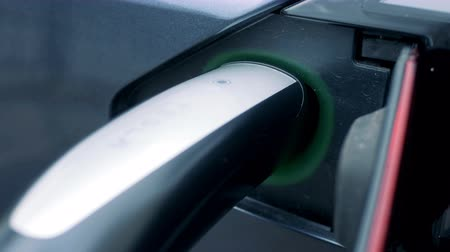 auto parking : Recharging process of an electric car with its socket being illuminated