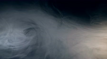 ethereal : Dense clouds of fume in contrast with darkness