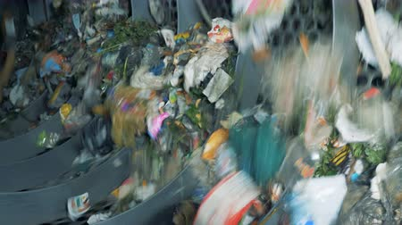 dumping : Discarded rubbish in a recycling center, close up. Stock Footage