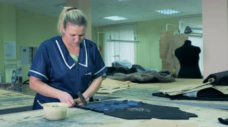 chamois : Female specialist is nailing pieces of fabric with a hammer