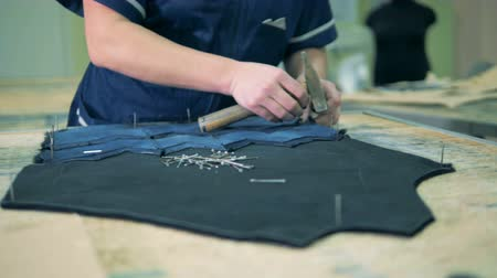 chamois : Close up of fabric elements getting nailed into a pattern Stock Footage