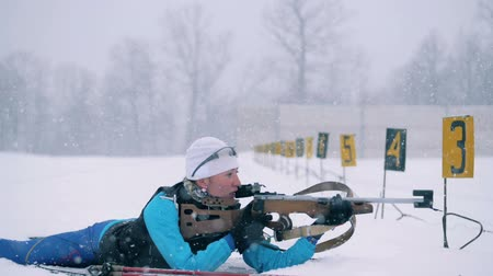 contestant : Shooting session of a lady contestant during biathlon race