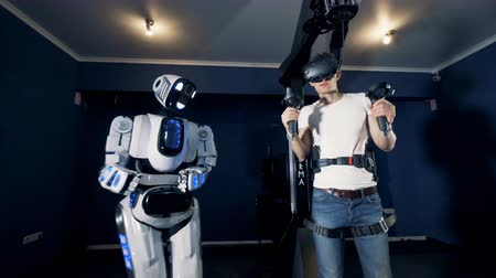 droid : A robot copies mans movements. Robotic VR cybernetic gaming system.