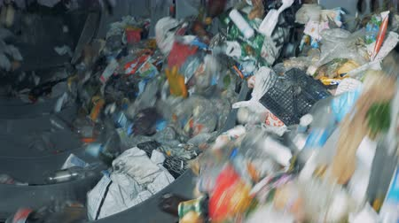 usado : Household trash sorted at a plant, close up. Stock Footage