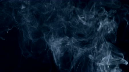 swirling : Gusts of mist are floating in the dark space Stock Footage