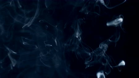 fişekçilik : Darkness is getting filled with fog, smoke, white abstract cloud. Stok Video