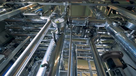 wort : Gauges and pipes at a brewery, bottom view.