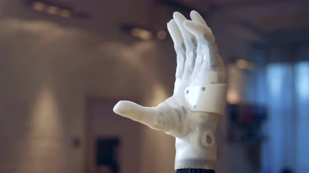 raising fist : Bionic arm. Real robotic hand.