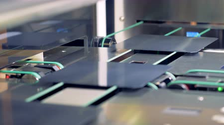 ストレート : Close up of solar cells moving straight forward the conveyor belt in a modern industrial equipment. 動画素材