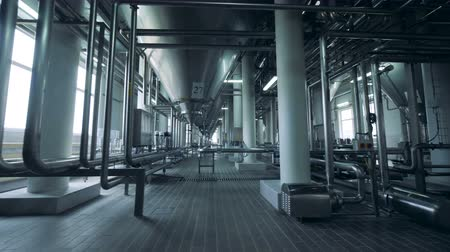 distillation : A big room with beer containers, close up.