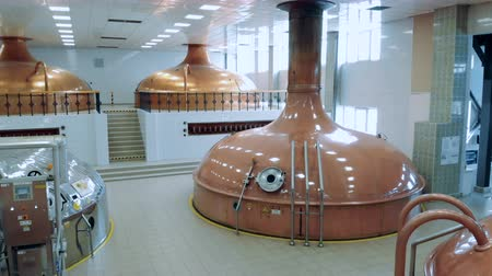 microbrewery : Massive brewing canisters in a distillery facility