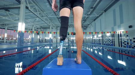 amputee : Male sportsman with prosthetic leg, close up. Stock Footage