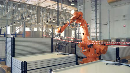 emme : Automated Robotic Arms Assembling innovative product - solar panels.