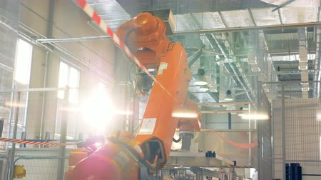 suction cups : Modern equipment robotic arm works at a factory.