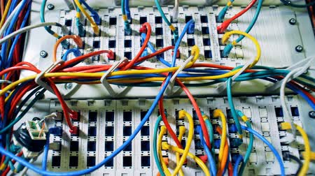yama işi : Lots of multicolored cords, wires, cables at a data center. Chaos, mess with wires.