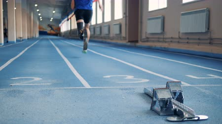 paralympics : Start of running exercise of a man with a robotic leg
