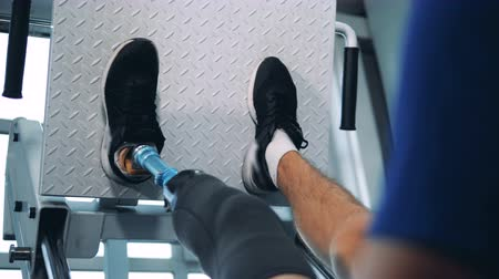 paralympics : A man with a bionic leg is doing a physical exercise Stock Footage