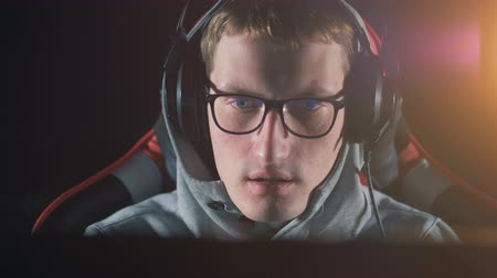 esports : Person talks while playing videogame, close up.