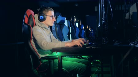 esports : One person plays game, sitting at a computer at a club, eSport Cyber Games concept. Stock Footage