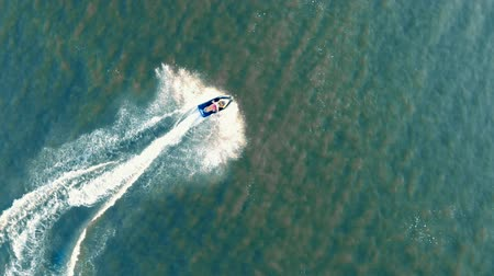 jet ski : Top view waverunner rider crossing the sea.