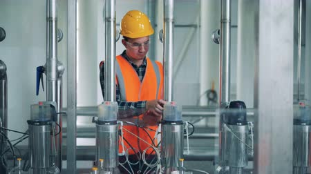 fermenting : A person checking brewery machines, close up. Stock Footage