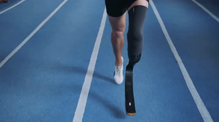 amputee : Professional runner with leg prosthesis, close up.