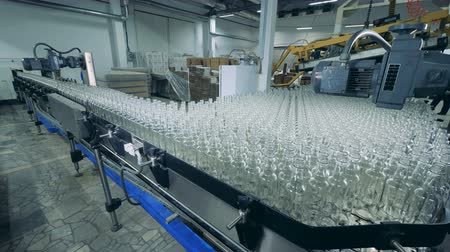 unfilled : Glass bottle are getting stacked together and slowly relocated Stock Footage