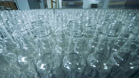 средства : Plenty of unfilled glass bottles in a factory