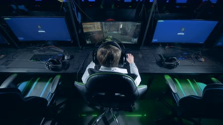 mmorpg : Backside view of a gamer playing a videogame Stock Footage