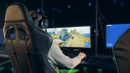armchairs : Computer monitor and a guy playing a videogame on it