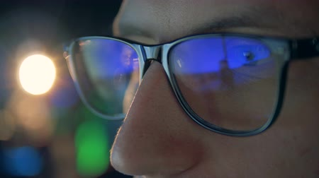mmorpg : Videogame reflecting in gamers glasses in a close up Stock Footage