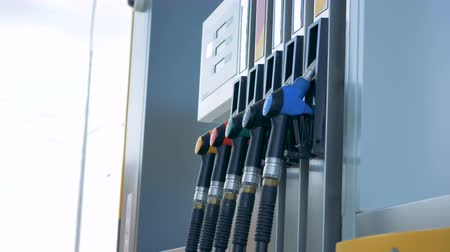 benzine : Petrol pump with a row of multicolour nozzles Stock Footage