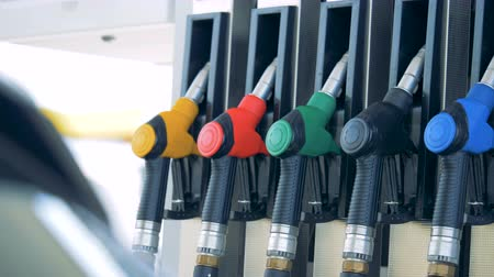 benzine : Gas pump with multiple nozzles inserted into it