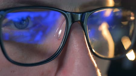 mmorpg : Computer game reflected in mans glasses in a close up