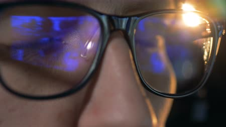 mmorpg : Close up of glasses put on a man with a computer game reflecting in them