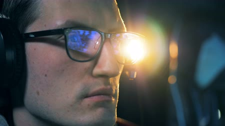 mmorpg : Face of a man in glasses playing a computer game in a close up Stock Footage